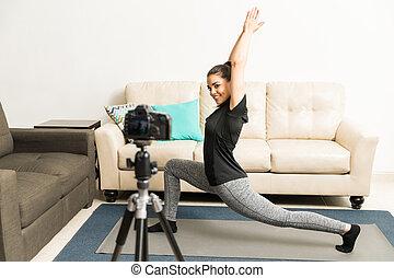 Fitness vlogger doing some yoga