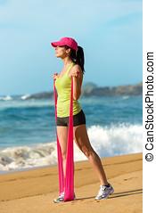 fitness, vrouw, met, tegenstand orkest