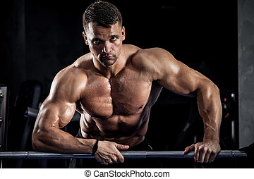 Fitness with barbell - Brutal athletic man pumping up ...