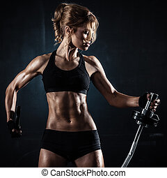 Fitness with barbell - Brutal athletic woman pumping up...