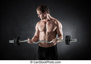 Fitness with barbell - Brutal athletic man pumping up...