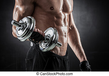 Fitness with dumbbells - Brutal athletic man pumping up ...