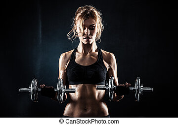 Fitness with dumbbells - Brutal athletic woman pumping up ...