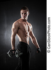 Fitness with dumbbells - Handsome athletic man pumping up ...