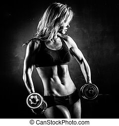 Fitness with dumbbells - Brutal athletic woman pumping up...