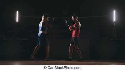fitness woman athlete boxing punching focus mitts enjoying...