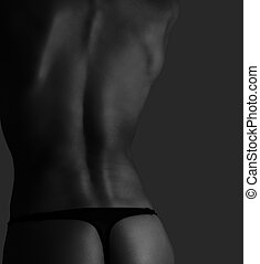 Fitness woman back side of body in black and white