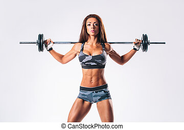 fitness woman - beautiful fitness female posing on studio...