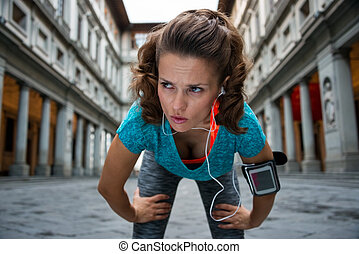 Fitness woman catching breathe near uffizi gallery in...