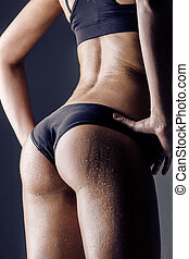 fitness woman - closeup of young female athlete back,...