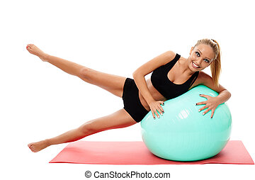 Fitness woman doing aerobics with a gym ball
