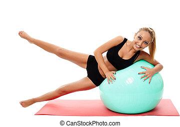Fitness woman doing aerobics with a gym ball