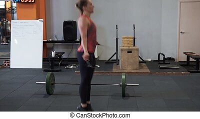 Fitness woman doing double jumping rope workout in gym