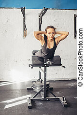woman doing exercise for buttocks on bench