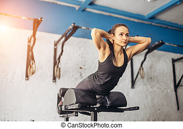 Fitness woman doing exercise for buttocks on bench
