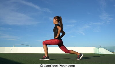 Fitness woman doing lunges exercises with twists