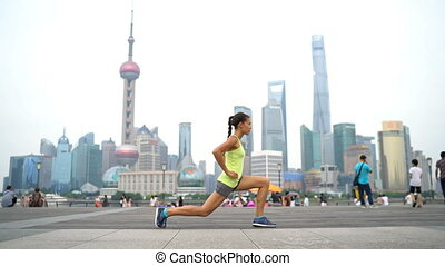 Fitness woman doing lunges exercising in Shanghai China. ...