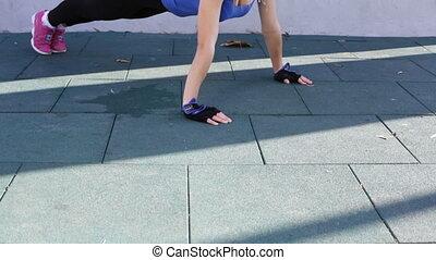 Fitness woman doing push ups - Woman athlete doing push ups...
