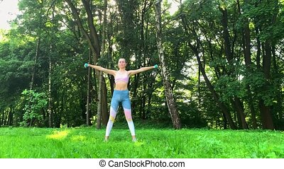 Fitness. Woman doing stretching exercise in park