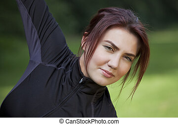 Fitness woman doing stretching