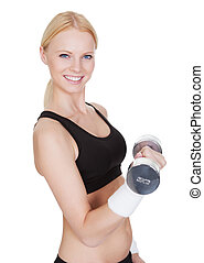 Beautiful young fitness woman doing weight training. Isolated on white
