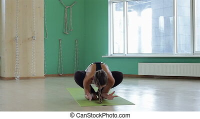 Fitness woman doing yoga exercise