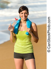 Fitness woman drinking