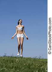 Fitness woman exercising in summer park