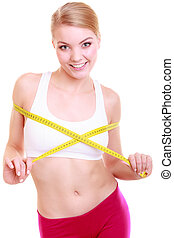 Fitness woman fit girl with measure tape measuring her bust...