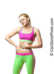 Fitness woman having pain in stomach over white