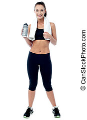 Attractive fitness woman posing after workout