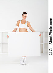 fitness woman holding white board