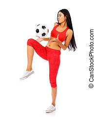 Fitness woman in a red sports suit with soccer balls