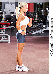 fitness woman lifting dumbbell in gym