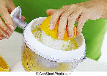 fitness woman make an orange juice