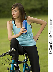 fitness woman on bike