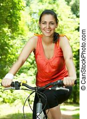Fitness woman on bike