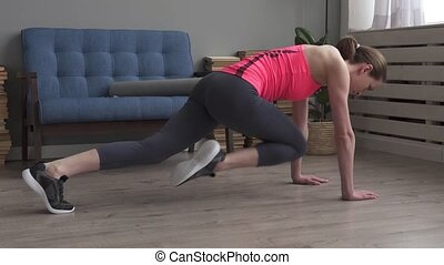 Fitness woman performing exercise mountain climber at home