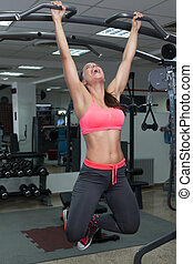 Fitness Woman Performing Hanging Leg Raises Exercise