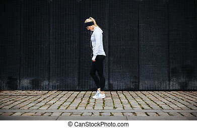 Fitness woman preparing for a city run