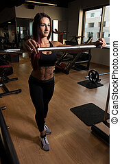 Fitness Woman Preparing To Exercising Legs Inside Gym