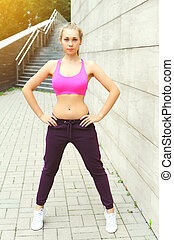 Fitness woman ready to workout in city, female athlete standing, sport and healthy lifestyle concept