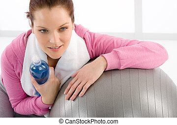 Fitness woman relax water bottle ball sportive