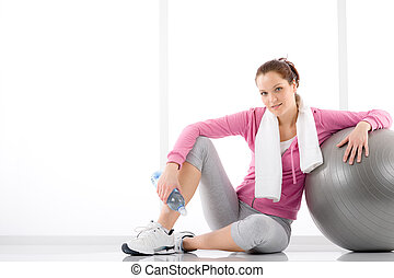 Fitness woman relax water bottle exercise ball