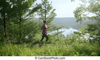 fitness woman running at forest trail