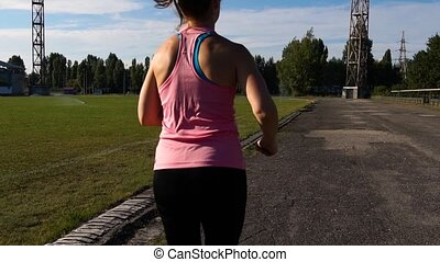 Fitness Woman Running at Sunny Summer Day