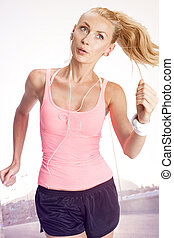 Fitness woman running.