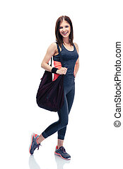 Fitness woman standing with bag