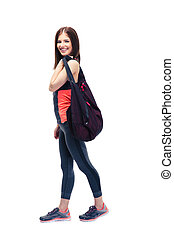 Fitness woman standing with sports bag