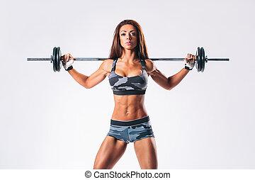 fitness woman - beautiful fitness female posing on studio...
